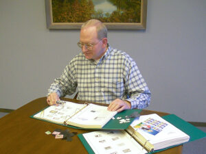 Collector with stamp album